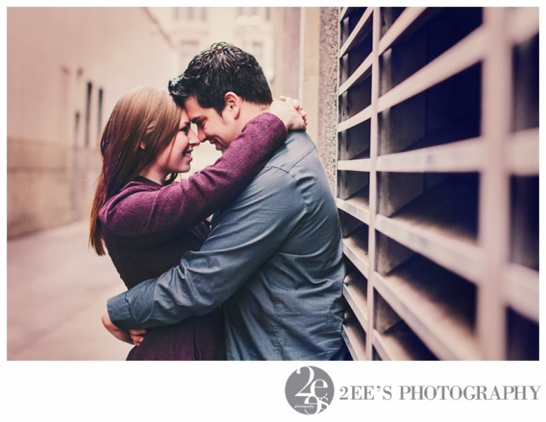 engagement photography in downtown spokane couple leaning against air vent